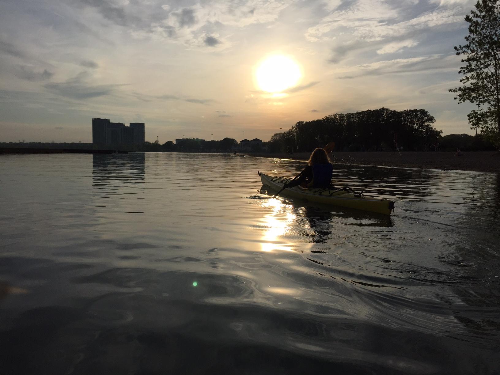 Kayaking on the lakeshore at sunset